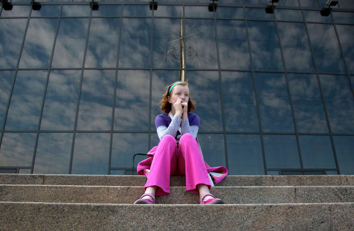 Fay Wagstaff of El Paso, Texas. sits on the front steps of the closed Smithsonian National Air and Space Museum in Washington, Tuesday, Oct. 1, 2013. Congress plunged the nation into a partial government shutdown Tuesday as a long-running dispute over President Barack Obama's health care law stalled a temporary funding bill, forcing about 800,000 federal workers off the job and suspending most non-essential federal programs and services. (AP Photo/Carolyn Kaster)