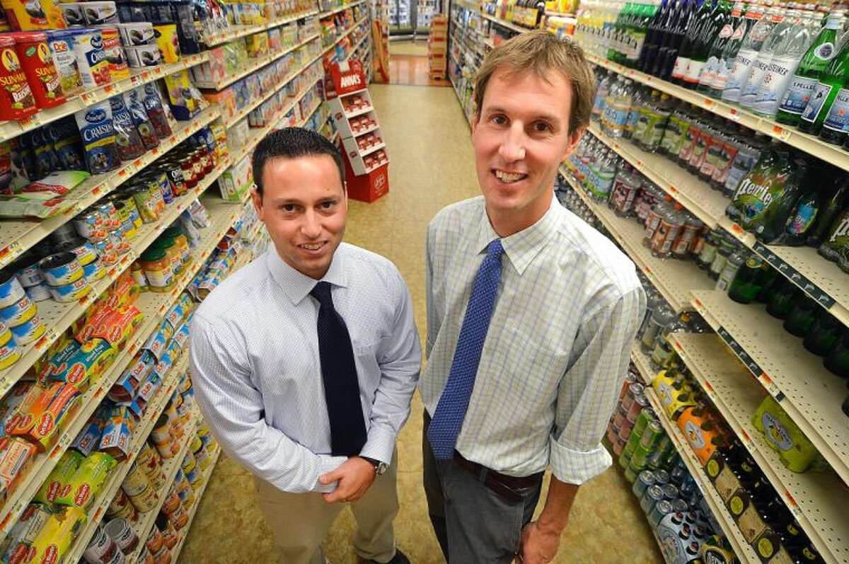 Hour Photo/Alex von Kleydorff . L-R Mike Picheco and Tim Dolnier, the new owners of The Village market in Wilton Center