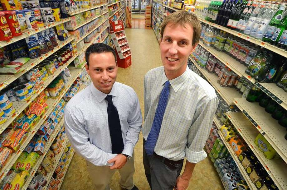 Hour Photo/Alex von Kleydorff . L-R Mike Picheco and Tim Dolnier, the new owners of The Village market in Wilton Center