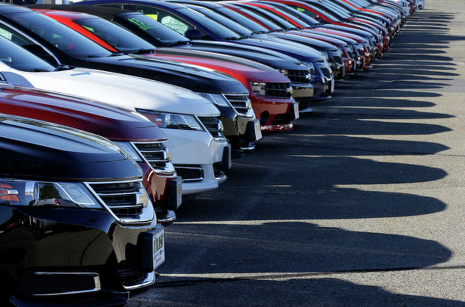 In this Wednesday, Sept. 18, 2013 photo Chevrolet passenger cars form a row on a dealer's lot in Needham, Mass. U.S. auto sales for September are released on Tuesday, Oct. 1, 2013. (AP Photo/Steven Senne_ / AP