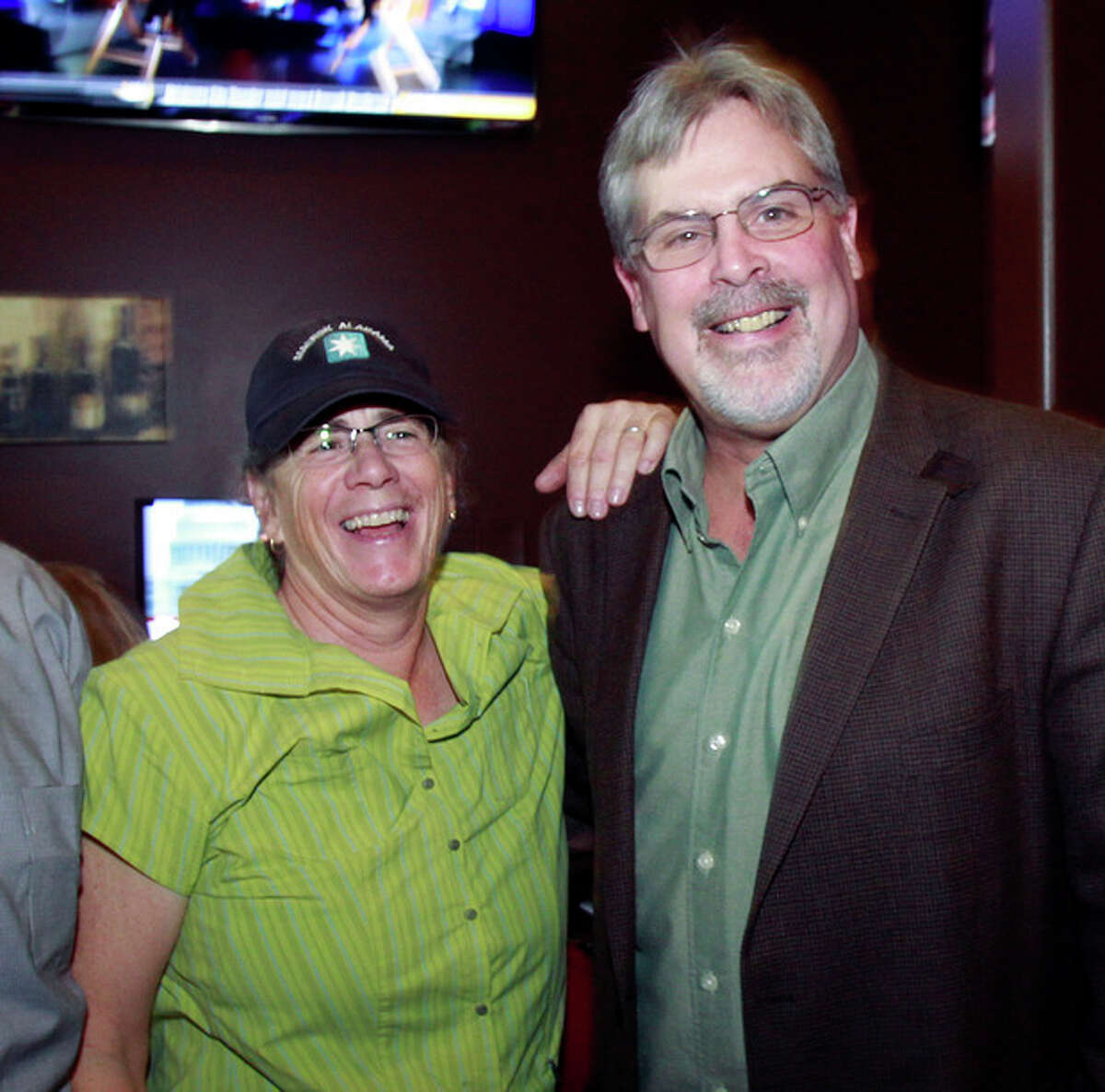 """Captain Richard Phillips, the real-life ship captain being played by Tom Hanks in the docudrama """"Captain Phillips,"""" right, enjoys a laugh with sister-in-law Lea Coggio, before a screening of """"Captain Phillips,"""" on Tuesday, Oct. 1, 2013 in Williston, Vt. The film was adapted from the captain?'s memoir about the 2009 hijacking of his vessel by Somali pirates. Phillips spent five days as a hostage of the pirates on a lifeboat, where he was beaten, tied up and threatened before he was rescued days later by U.S. Navy SEALs. (AP Photo/Toby Talbot)"""