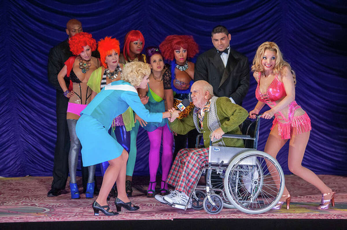 """This Sept. 15, 2013 image released by the Booklyn Academy of Music shows, foreground from left, Sarah Coomes, Robert Brubaker and Sarah Joy Miller in a Scene from """"Anna Nicole"""" composed by Mark-Anthony Turnage at the Brooklyn Academy of Music Opera House in the brooklyn borough of New York. New York City Opera says it likely will fail in its goal to raise $7 million by Monday, the deadline it set for suspending the bulk of its 2013-14 season. (AP Photo/BAM, Stephanie Berger)"""