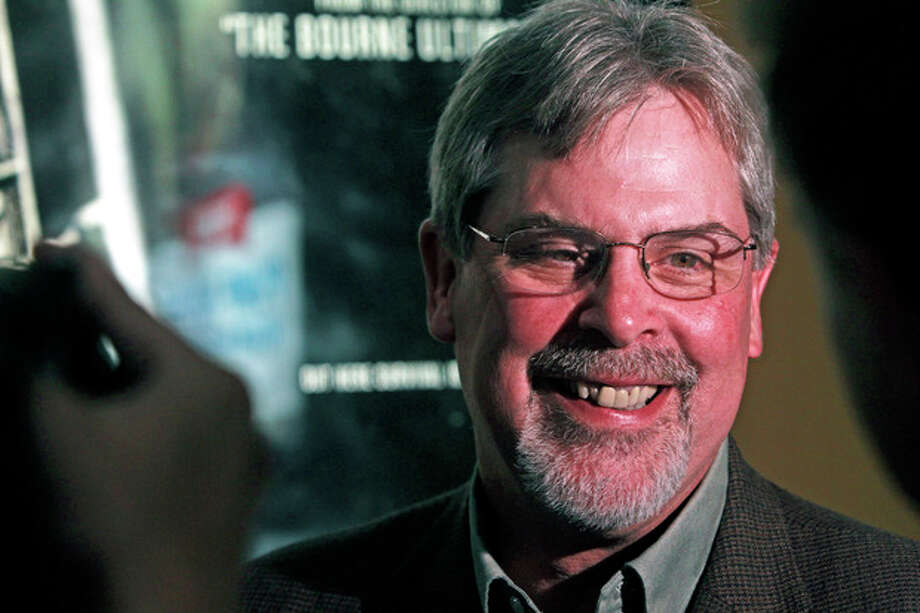 """Captain Richard Phillips, the real-life ship captain being played by Tom Hanks in the docudrama """"Captain Phillips,"""" left, smiles during an interview before a screening of """"Captain Phillips,"""" on Tuesday, Oct. 1, 2013 in Williston, Vt. The film was adapted from the captain's memoir about the 2009 hijacking of his vessel by Somali pirates. Phillips spent five days as a hostage of the pirates on a lifeboat, where he was beaten, tied up and threatened before he was rescued days later by U.S. Navy SEALs. (AP Photo/Toby Talbot) / AP"""