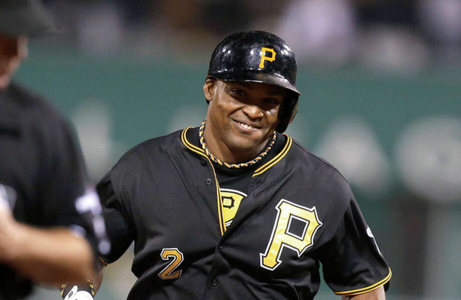 Pittsburgh Pirates' Marlon Byrd smiles as he rounds the bases after hitting a home run in the second inning of the NL wild-card playoff baseball game against the Cincinnati Reds on Tuesday, Oct. 1, 2013, in Pittsburgh. (AP Photo/Gene J. Puskar) / ap