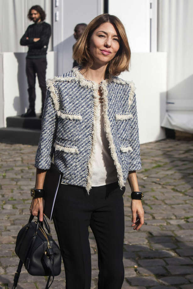 Sofia Coppola leaves after attending the presentation of Vuitton's ready-to-wear Spring/Summer 2014 fashion collection, presented Wednesday, Oct. 2, 2013 in Paris. (AP Photo/Thibault Camus)