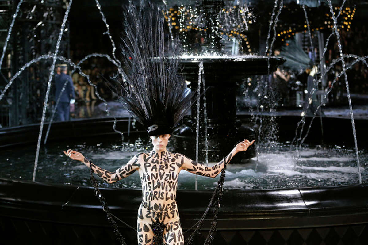 EDS NOTE NUDITY - A model presents a creation as part of Vuitton's ready-to-wear Spring/Summer 2014 fashion collection, presented Wednesday, Oct. 2, 2013 in Paris. (AP Photo/Jacques Brinon)