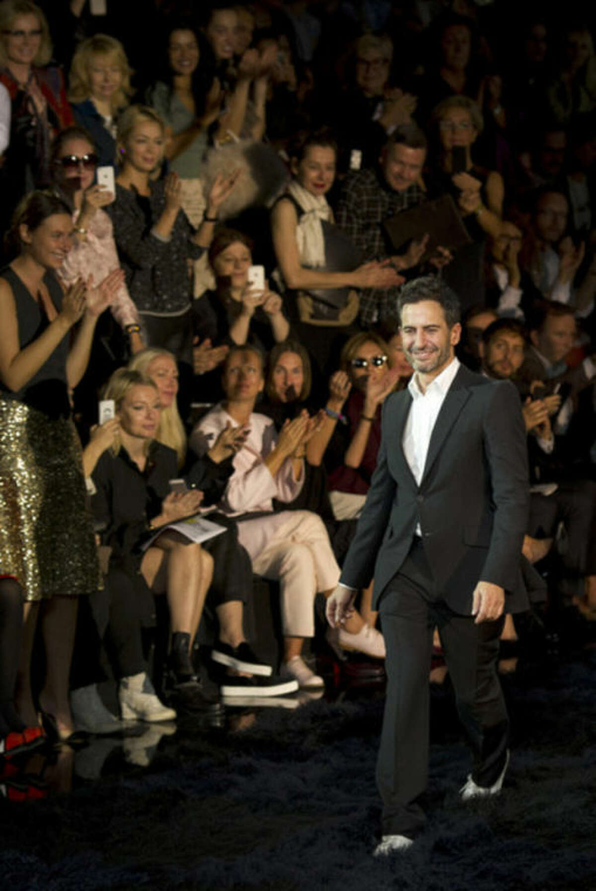 Fashion designer Marc Jacobs acknowledges applause following the presentation of the ready-to-wear Spring/Summer 2014 fashion collection he designed for Vuitton, Wednesday, Oct. 2, 2013 in Paris. (AP Photo/Jacques Brinon)