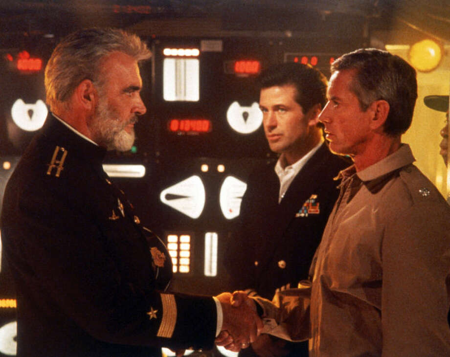 "FILE - This undated file image provided by Paramount Studios shows a scene from ""The Hunt for Red October"" starring, from left, Sean Connery, Alec Baldwin and Scott Glenn. The film is based on the book by Tom Clancy. Clancy, the bestselling author of ""The Hunt for Red October"" and other wildly successful technological thrillers, has died. He was 66. Penguin Group (USA) said Wednesday, Oct. 2, 2013, that Clancy died Tuesday in Baltimore. The publisher did not disclose a cause of death. (AP Photo/Paramount Studios)"