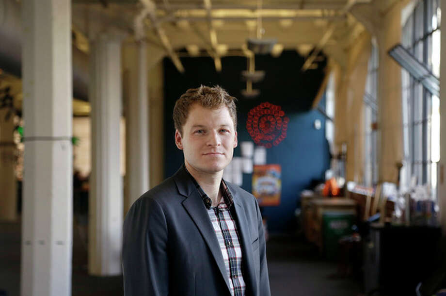 In this Monday, Sept. 30, 2013 photo, Trip Adler, CEO of Scribd, an online document reading service, poses for photographs at his office in San Francisco. Scribd is taking a page from Netflix's success story as it sets out to create the world's largest subscription service for digital books. (AP Photo/Jeff Chiu) / AP