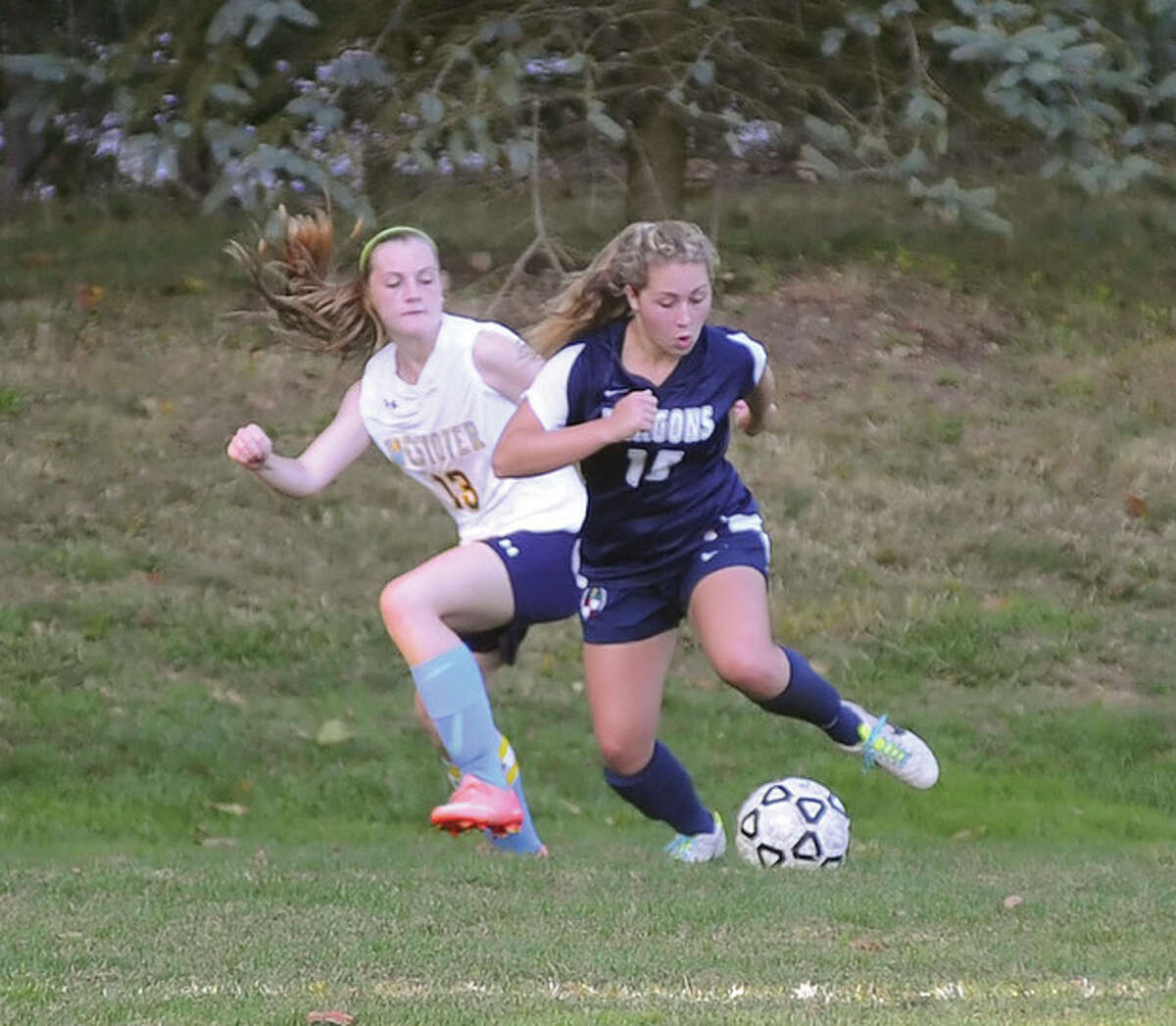 Hour photo/John Nash Greens Farms girls soccer player Olivia Lennon turns up field with the ball as a Westover player defends during Wednesday's game in Westport.