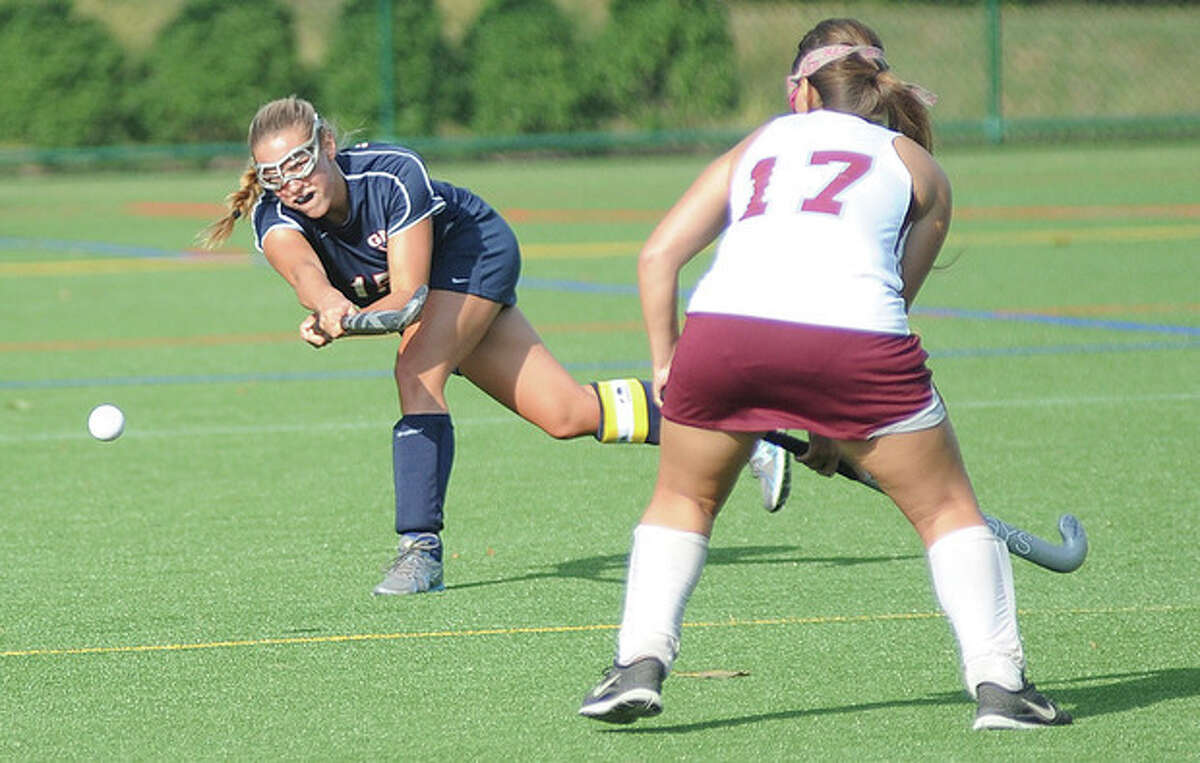 Hour photo/John Nash Greens Farms midfielder Hayley Holzinger, left, its the ball up field as Hopkins School's Nat Klingher defends during Wednesday's game in Westport. The Dragons handed visiting Hopkins a 2-0 defeat.