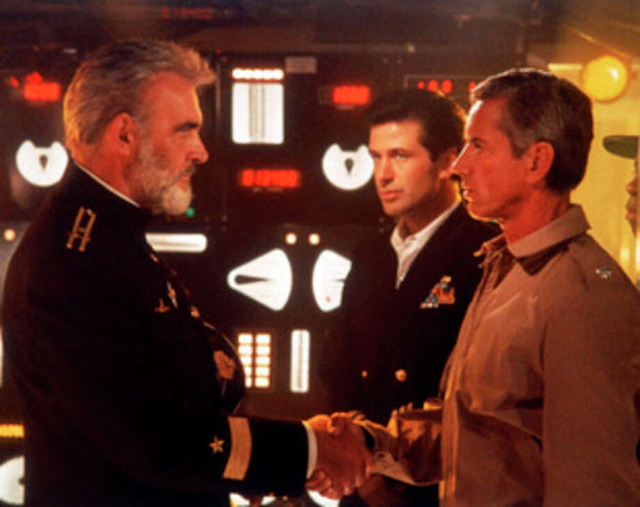 "FILE - This undated file image provided by Paramount Studios shows a scene from ""The Hunt for Red October"" starring, from left, Sean Connery, Alec Baldwin and Scott Glenn. The film is based on the book by Tom Clancy. Clancy, the bestselling author of ""The Hunt for Red October"" and other wildly successful technological thrillers, has died. He was 66. Penguin Group (USA) said Wednesday, Oct. 2, 2013, that Clancy died Tuesday in Baltimore. The publisher did not disclose a cause of death. (AP Photo/Paramount Studios) / Paramount"