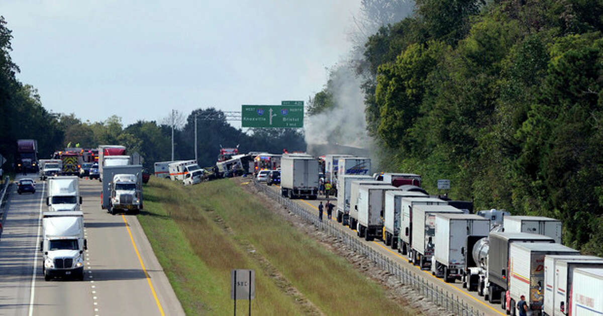 Emergency personnel arrive on the scene near a collision involving a bus on I-40, in Dandridge, Tenn, on Wednesday, Oct. 2, 2013. A spokeswoman for Tennessee's Safety Department says there are multiple fatalities and injuries in an interstate bus crash between a passenger bus, a tractor-trailer and another vehicle. (AP Photo/The Knoxville News Sentinel, Michael Patrick)