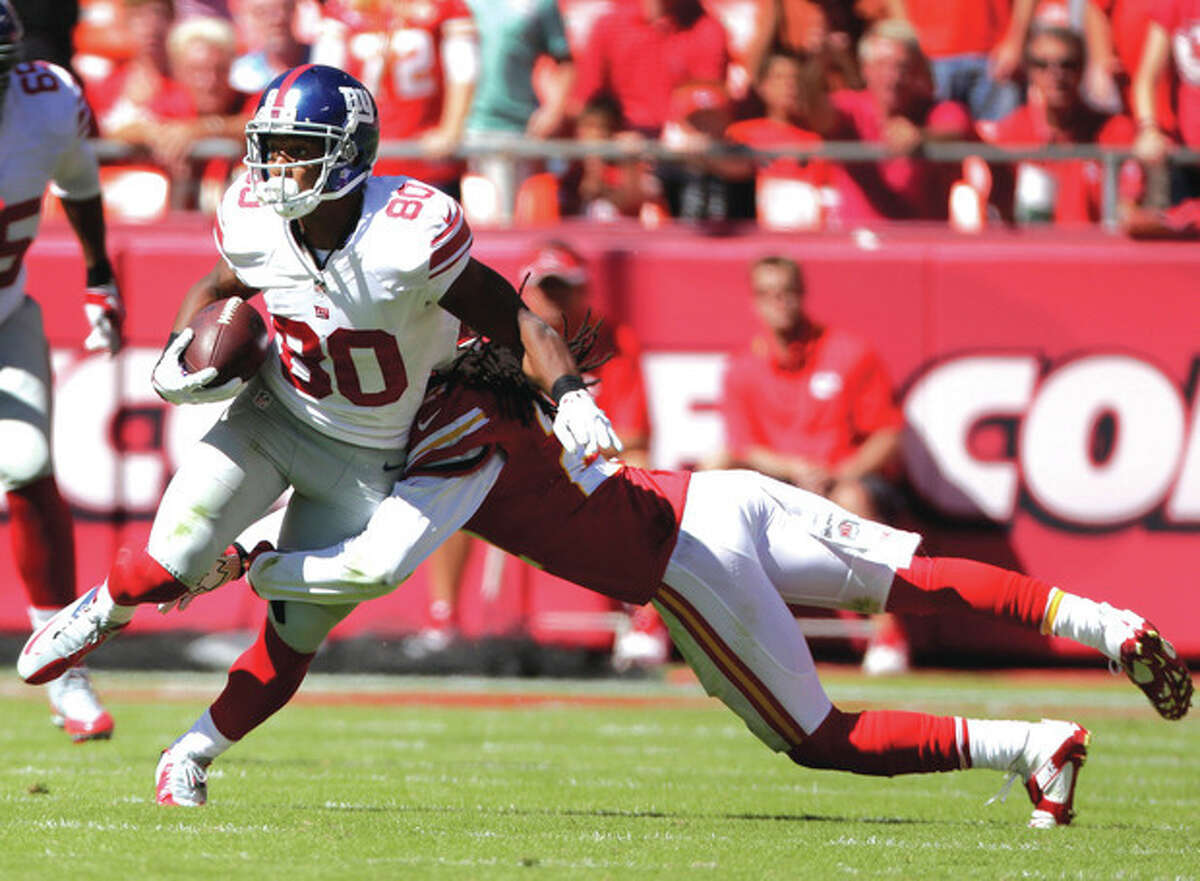 AP photo New York Giants wide receiver Victor Cruz (80) is tackled after a reception during last weekend's game in Kansas City. While the Giants have struggled on offense, Cruz's production has been solid.
