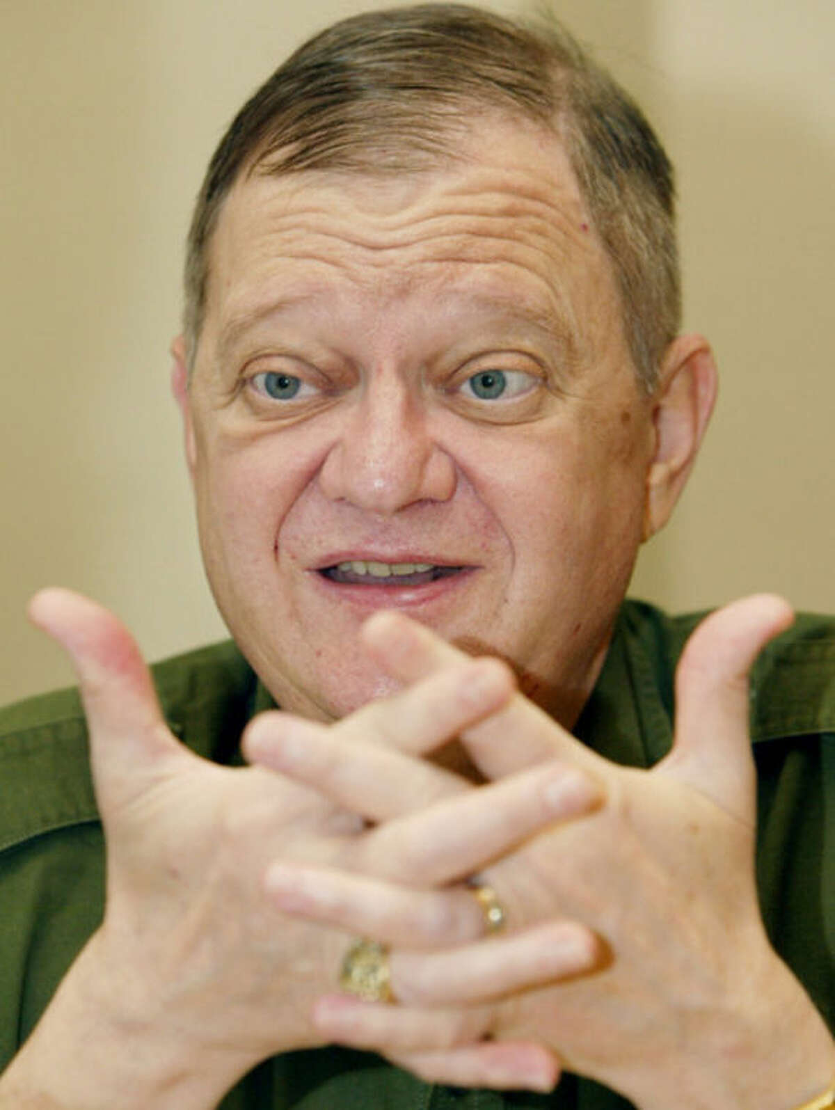 FILE - This May 24, 2004 file photo, Author Tom Clancy gestures during an interview in New York. Clancy, the bestselling author of