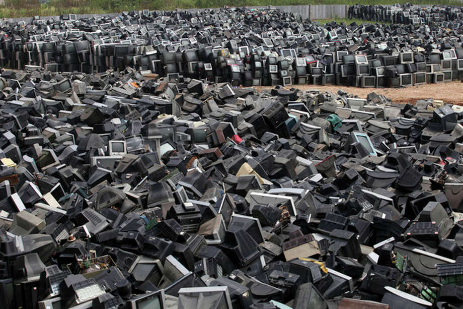 In this photo taken Aug. 26, 2013, discarded television sets pile up in a scrap yard awaiting recycling in Zhuzhou city in south China's Hunan province. China's recycling industry has boomed over the past 20 years. Its manufacturers needed the metal, paper and plastic and Beijing was willing to tolerate the environmental cost. But environmentalists have long complained the industry is poisoning China's air, water and soil. (AP Photo) CHINA OUT / CHINATOPIX
