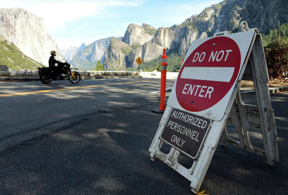 This Tuesday, Oct. 1, 2013, photo shows a sign alerting motorists of the closure of Yosemite National Park, Calif. due to the government shutdown. President Barack Obama brought top lawmakers to the White House on Wednesday, Oct. 2, as Republicans rejected Democratic demands to vote on legislation ending a two-day partial government shutdown without changes to the nation's three-year-old health care law. (AP Photo/The Fresno Bee, Craig Kohlruss) / The Fresno Bee