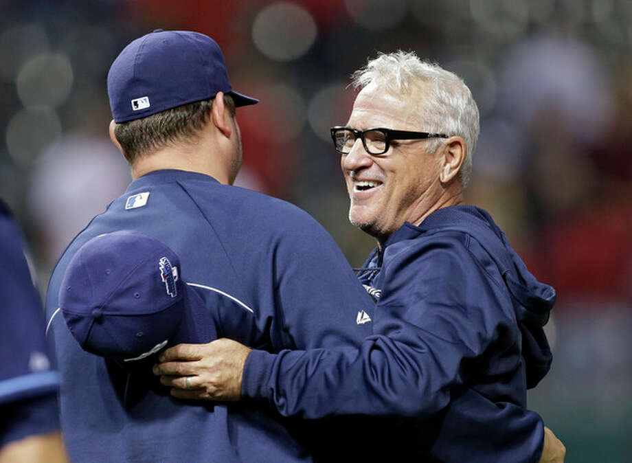Tampa Bay Rays manager Joe Maddon, right, celebrates after a 4-0 win over the Cleveland Indians in the AL wild-card baseball game Wednesday, Oct. 2, 2013, in Cleveland. (AP Photo/Tony Dejak) / AP