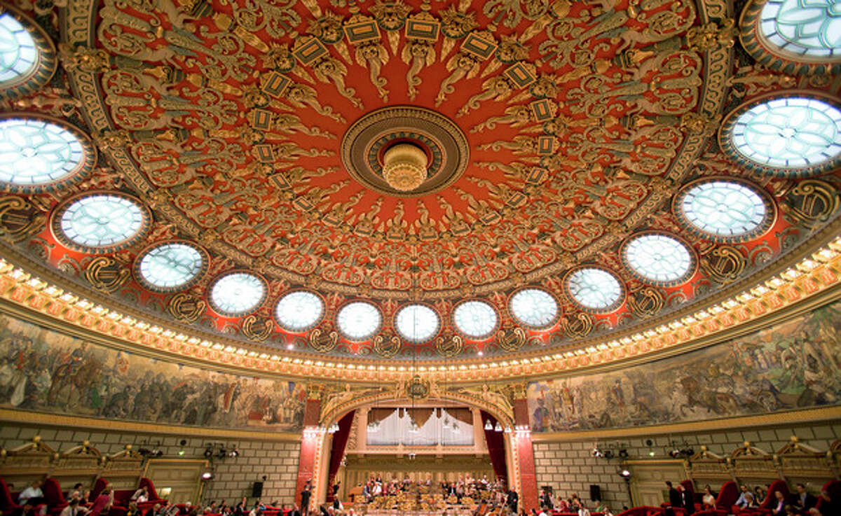 This Sept. 24, 2013 photo shows the main concert hall at the Romanian Athenaeum in Bucharest, Romania, before a concert of the George Enescu classical music festival. The festival which began in 1958 is named after Romanian composer, violinist and conductor George Enescu, who lived in Romania and moved to Paris when the communists came to power. (AP Photo/Vadim Ghirda)