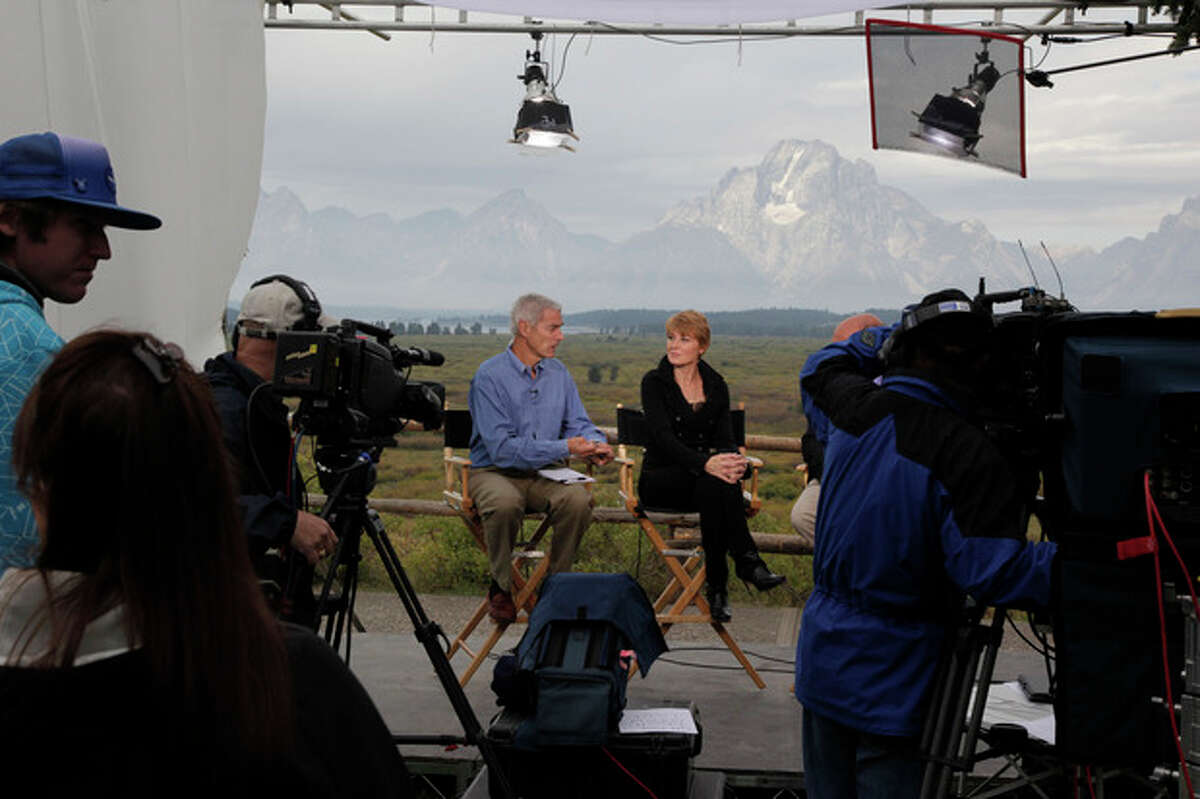 """FILE - In this Aug. 31, 2012, file photo, Diane Swonk, center right, chief economist and senior managing director of Mesirow Financial, is interviewed on on a CNBC television set at Grand Teton National Park near Jackson Hole, Wyo. The Labor Department says it will not release the highly anticipated September jobs report on Friday because the government remains shuttered. Swonk says """"The jobs report is a ?""""flashlight into the dense forest of global economic information..We?'ve turned the flashlight off."""" (AP Photo/Ted S. Warren)"""