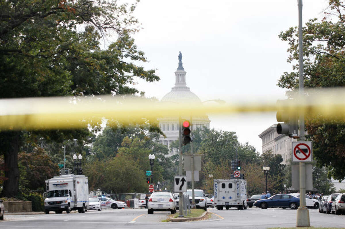 Police respond to a shooting on Capitol Hill in Washington, Thursday, Oct. 3, 2013. Police say the U.S. Capitol has been put on a security lockdown amid reports of possible shots fired outside the building. (AP Photo/Molly Riley)