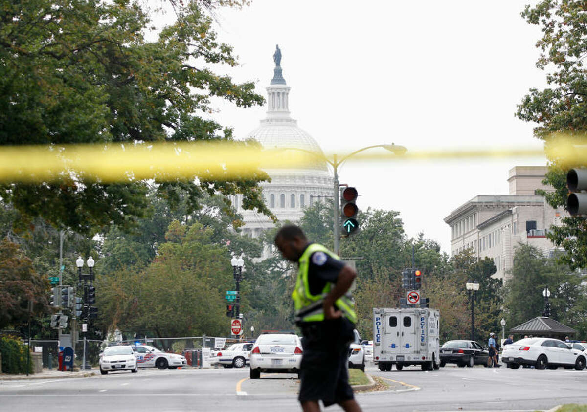 Police respond to a shooting on Capitol Hill in Washington, Thursday, Oct. 3, 2013. A police officer was reported injured after gunshots at the U.S. Capitol, police said Thursday. They locked down the entire complex, at least temporarily derailing debate over how to end a government shutdown. (AP Photo/Molly Riley)