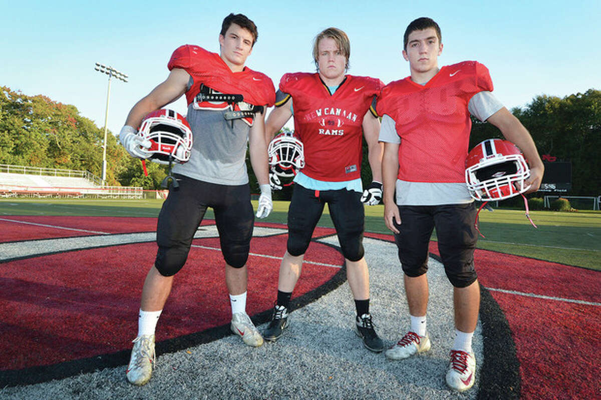 Hour Photo/Alex von Kleydorff New Canaan High School football players, from left, Mike Root, Connor Buck and Cole Harris are making a name for themselves this high school season.