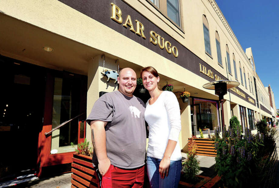 Hour photo / Erik TrautmanBar Sugo owner and chef, Pasquale Pascarella, and his fiance and partner Megan D'Amico celbrate their restaurant's one year anniversay on Wall Street. / (C)2013, The Hour Newspapers, all rights reserved