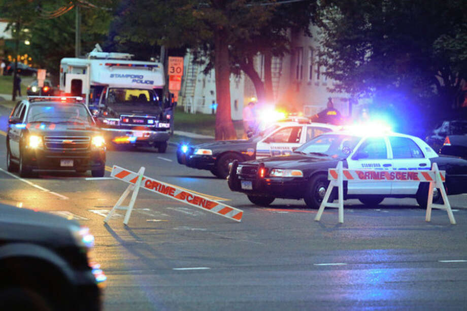 Stamford police block off Bridge Street outside of the Woodside Green condominiums thought to be the home of a woman killed by police in Washington, DC Thursday evening. Hour Photo / Chris Palermo / © 2013 Hour Newspapers All Rights Reserved