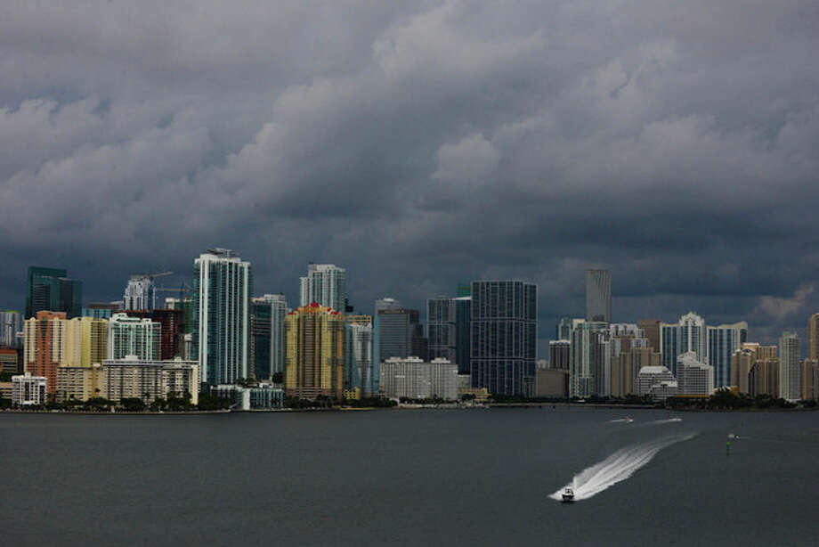 Downtown Miami is engulfed in storm clouds as Tropical Storm Karen heads toward Florida's Panhandle on Thurdsay, Oct. 3, 2013. The storm threatened to become the first named tropical system to menace the United States this year. (AP Photo/The Miami Herald, Shannon Kaestle) MAGS OUT / The Miami Herald