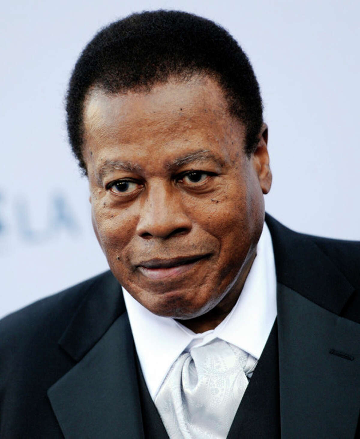 FILE - In this Sept. 27, 2011 file photo, saxophonist Wayne Shorter poses at the Los Angeles Philharmonic Opening Night Gala, in Los Angeles. Shorter, who turned 80 on Aug. 25, 2013, is still going strong. He was a quadruple winner in this year?'s Downbeat magazine critics poll, topping the categories for Jazz Artist, Jazz Album, Jazz Group and Soprano Saxophone. Earlier this year, he was awarded the UNESCO Medal of the Five Continents award for his lifetime contribution to jazz. (AP Photo/Chris Pizzello, File)