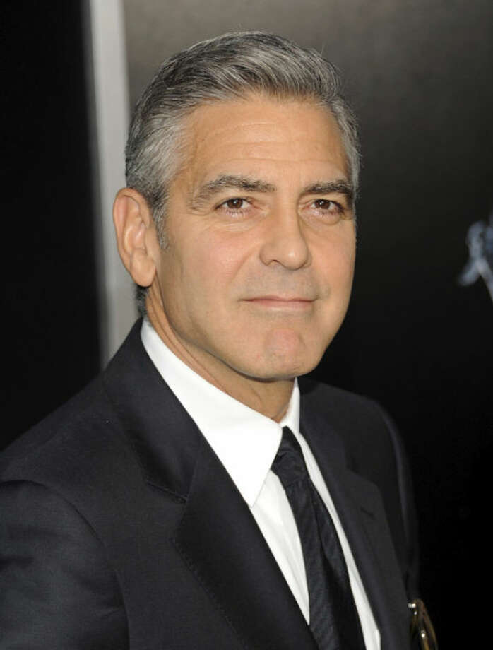"Actor George Clooney attends the premiere of ""Gravity"" at the AMC Lincoln Square Theaters on Tuesday, Oct. 1, 2013, in New York. (Photo by Evan Agostini/Invision/AP)"