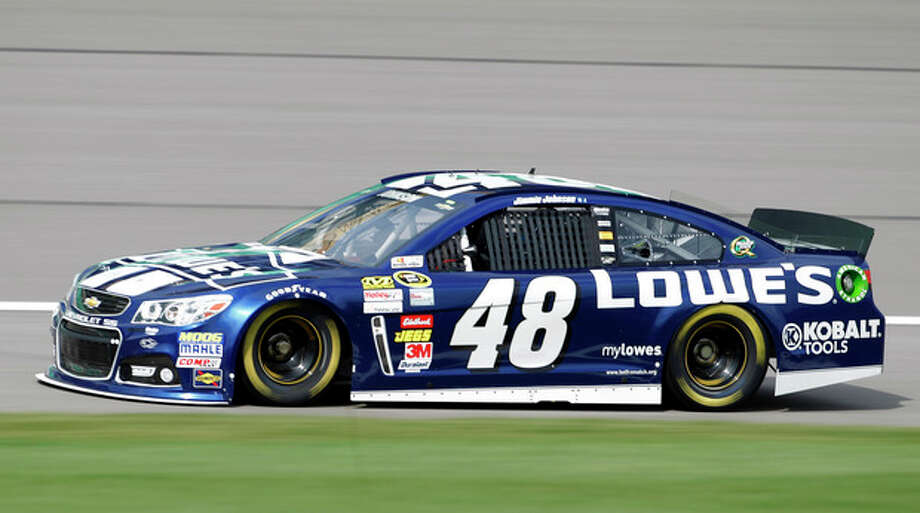 Driver Jimmie Johnson takes a lap during practice for Sunday's NASCAR Sprint Cup series auto race at Kansas Speedway in Kansas City, Kan., Friday, Oct. 4, 2013. (AP Photo/Colin E. Braley) / FR123678 AP