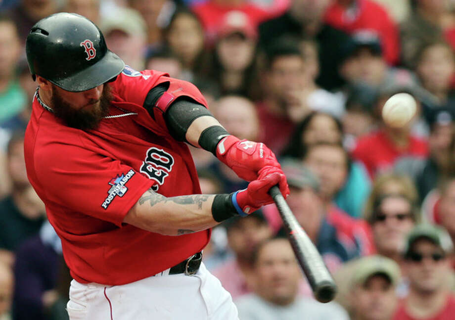 Boston Red Sox left fielder Jonny Gomes hits a two-run double off Tampa Bay Rays starting pitcher Matt Moore in the fourth inning in Game 1 of baseball's American League division series, Friday, Oct. 4, 2013, in Boston. (AP Photo/Charles Krupa) / AP
