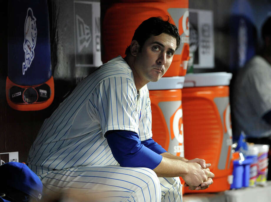 FILE - In this April 19, 2013, file photo, New York Mets starting pitcher Matt Harvey sits the dugout during a baseball game against the Washington Nationals in New York. The Mets said Friday, Oct. 4, 2013, that Dr. James Andrews will operate on Harvey's partially torn ligament in his right elbow in October. (AP Photo/Kathy Kmonicek, File) / FR170189 AP