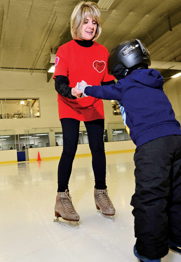 Karen Christensen is a Wilton resident and ice skating coach at Stamford Twin Rinks. Despite having heart surgery at 6 years old, she went on to fulfill her dreams of skating with the national touring Ice Capades. Christensen will be honored at the American Heart Association's Fairfield County Heart Walk later this month.