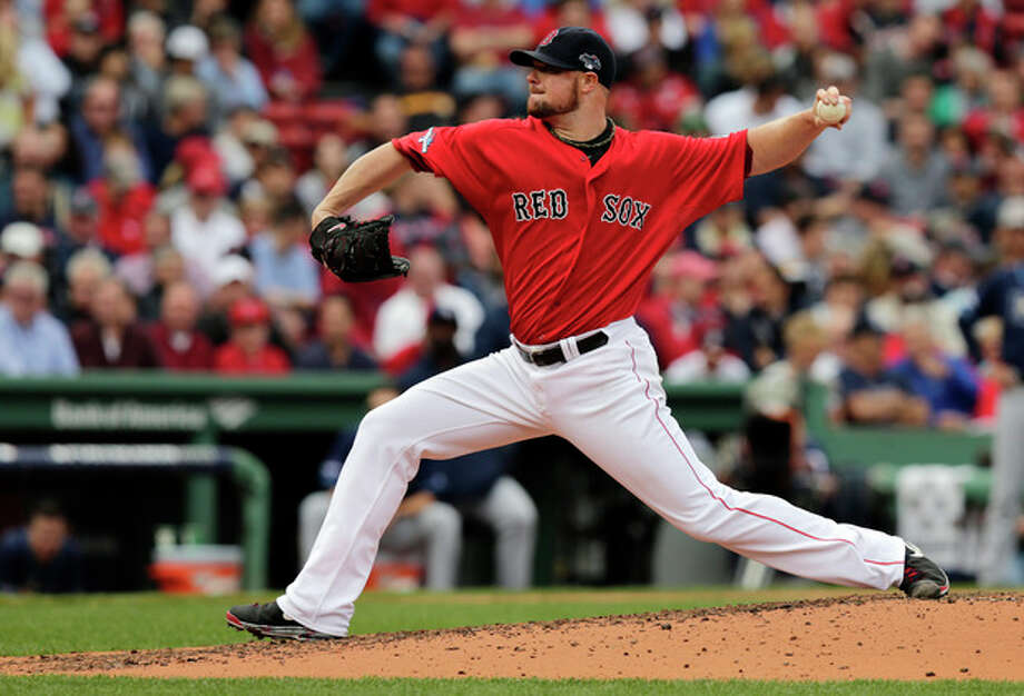 Boston Red Sox starting pitcher Jon Lester delivers against the Tampa Bay Rays in the third inning in Game 1 of baseball's American League division series on Friday, Oct. 4, 2013, in Boston. (AP Photo/Charles Krupa) / AP