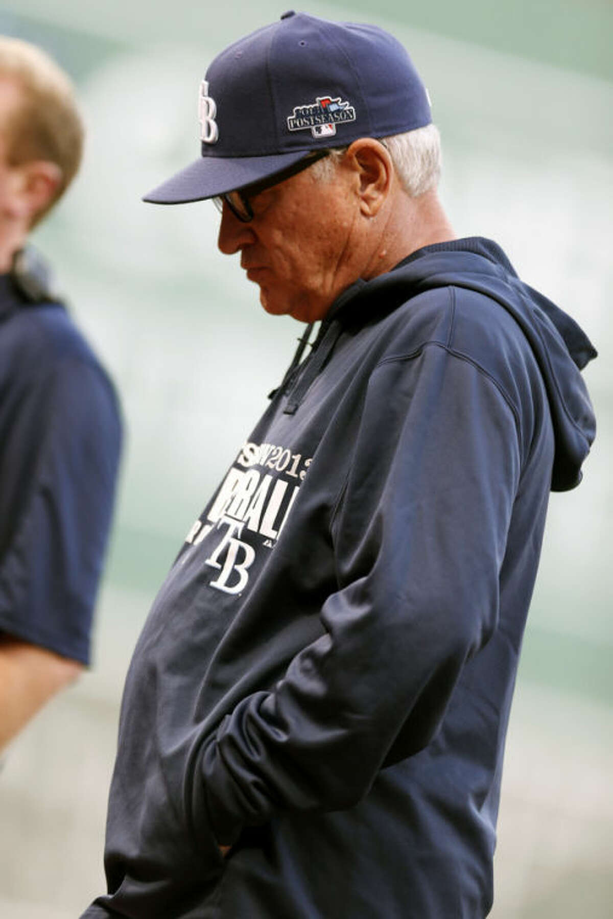 Tampa Bay Rays manager Joe Maddon walks to the dugout after making a pitching change in the sixth inning in Game 1 of baseball's American League division series against the Boston Red Sox, Friday, Oct. 4, 2013, in Boston. (AP Photo/Michael Dwyer)