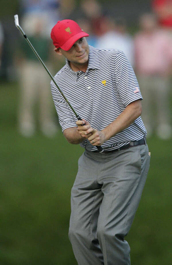 United States's Bill Haas reacts to missing a shot on the 15th hole during a foursome match at the Presidents Cup golf tournament at Muirfield Village Golf Club Friday, Oct. 4, 2013, in Dublin, Ohio. (AP Photo/Jay LaPrete)