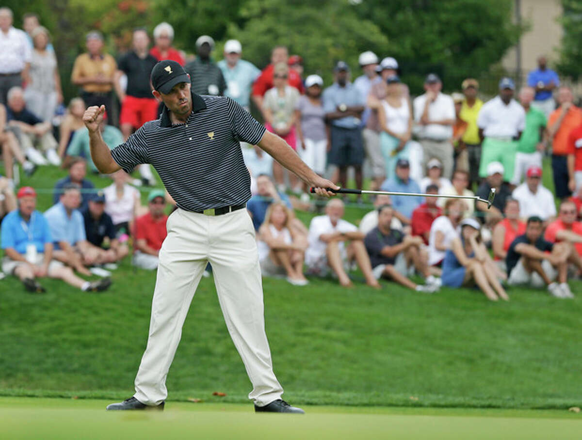 International team player Charl Schwartzel, of South Africa, reacts to making a birdie putt on the fourth hole during a foursome match at the Presidents Cup golf tournament at Muirfield Village Golf Club, Friday, Oct. 4, 2013, in Dublin, Ohio. (AP Photo/Darron Cummings)