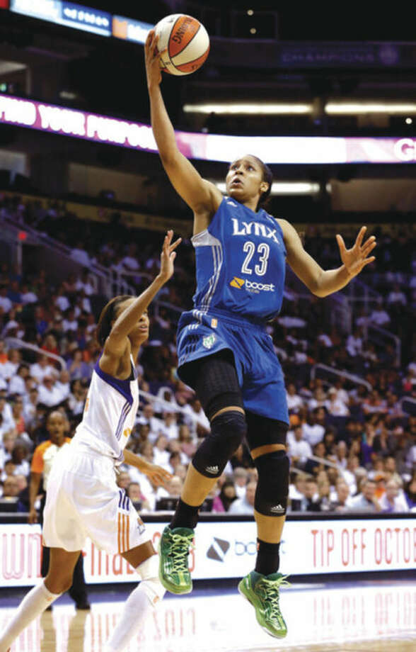 Minnesota Lynx's Maya Moore (23) scores as she gets past Phoenix Mercury's DeWanna Bonner, left, during the second half in a WNBA Western Conference Finals basketball game on Sunday, Sept. 29, 2013, in Phoenix. The Lynx defeated the Mercury 72-65 and won the Western Conference Finals 2-0, earning a trip to the WNBA Finals to face the Atlanta Dream. (AP Photo/Ross D. Franklin)