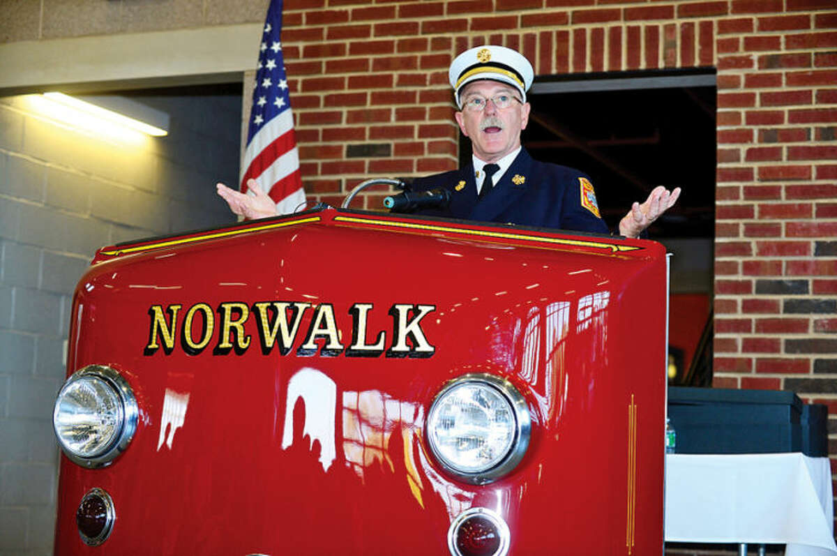 Hour photo / Erik Trautmann Fire Cief Denis McCarthy welcomes guests as the City of Norwalk and the Fire Department formally dedicates the new Central Fire Station Saturday.