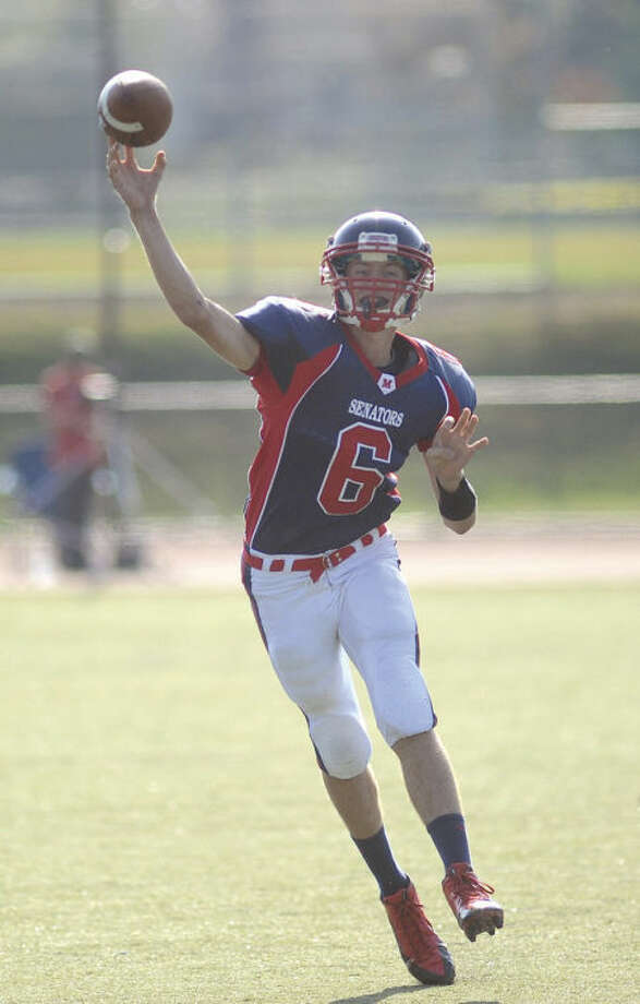 Hour photo/John NashBrien McMahon quarterback Matt Downey fires a pass up field during Saturday's game at Casagrande Field in Norwalk. McMahon defeated Westhill 21-15.
