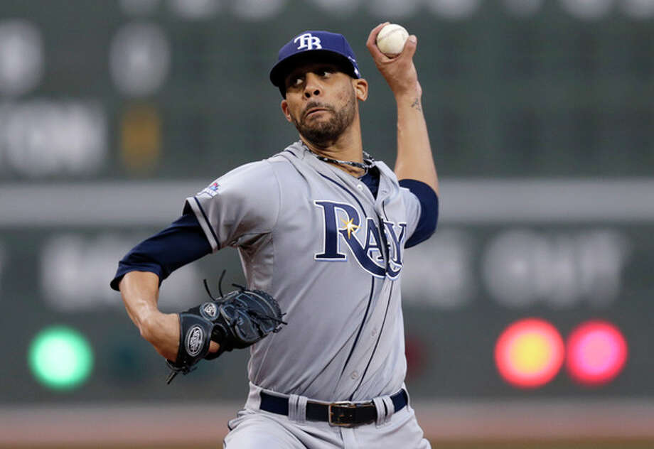 Tampa Bay Rays starting pitcher David Price winds up in the first inning against the Boston Red Sox during Game 2 of baseball's American League division series, Saturday, Oct. 5, 2013, in Boston. (AP Photo/Charles Krupa) / AP