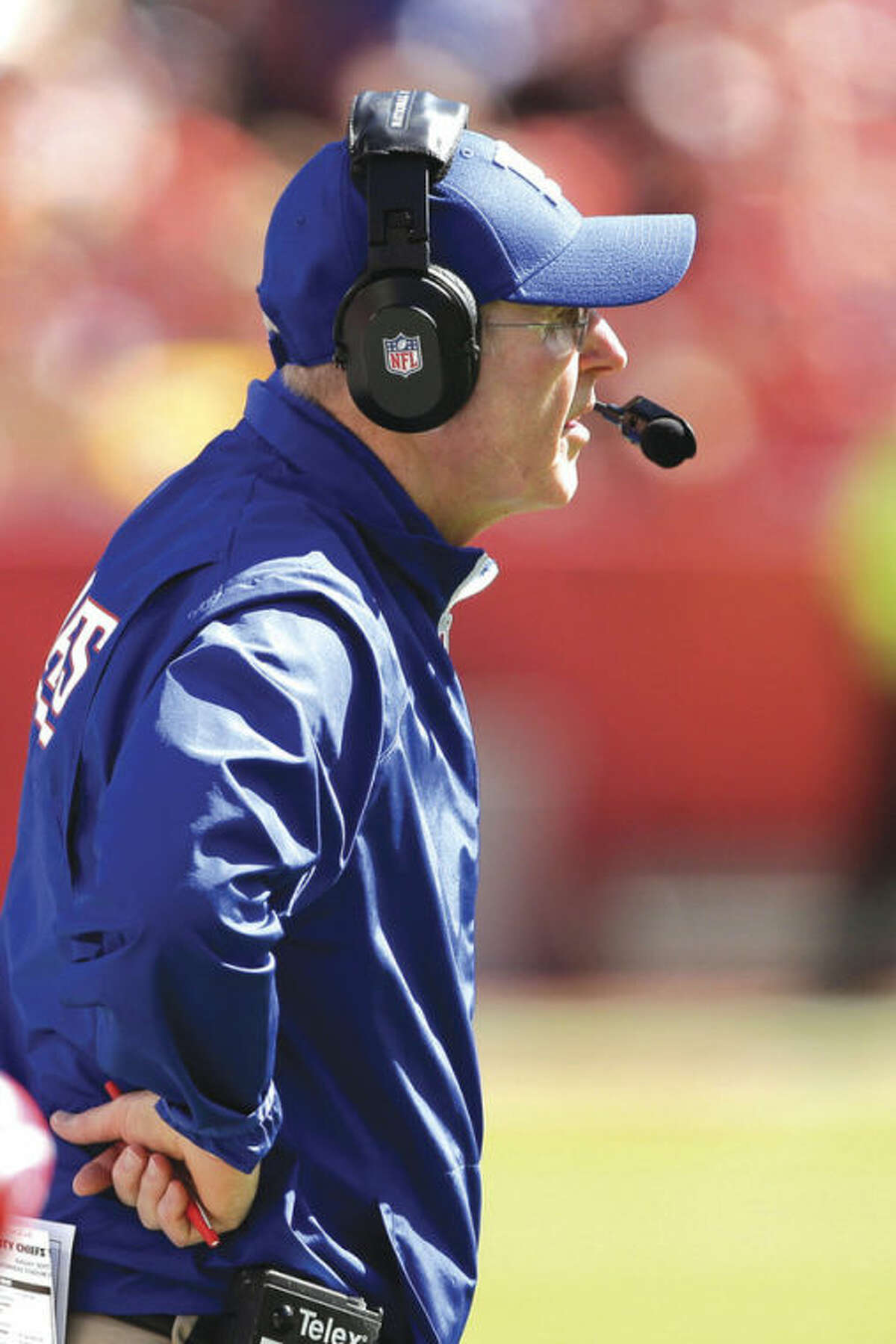 New York Giants head coach Tom Coughlin watches during the second half of an NFL football game against the Kansas City Chiefs at Arrowhead Stadium in Kansas City, Mo., Sunday, Sept. 29, 2013. (AP Photo/Charlie Riedel)