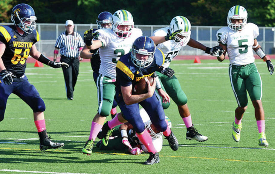 Hour photo/Erik TrautmannWeston quarterback Erik Dammen-Brower, center, heads for the end zone to score during Saturday's game against New Milford. / (C)2013, The Hour Newspapers, all rights reserved