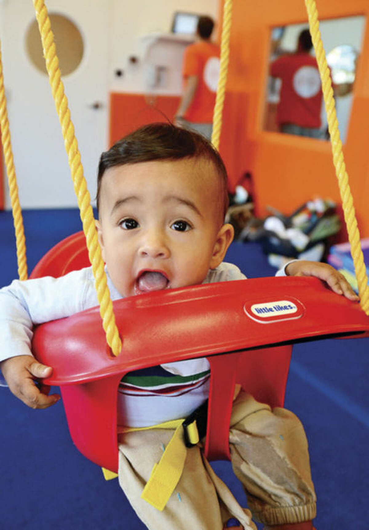 7 month old Lincoln Martell, swings at Kidsville in Westport where they announce thed opening of their new 4,800 square foot facility at 1572 Post Road East Tuesday. Hour photo / Erik Trautmann