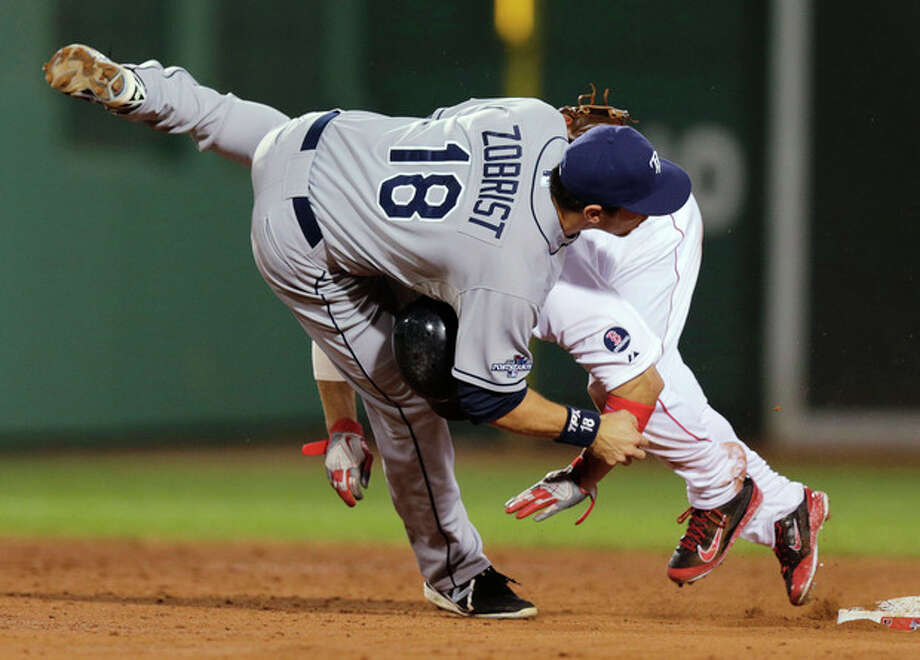 Boston Red Sox's Shane Victorino rear, collides with Tampa Bay Rays second baseman Ben Zobrist (18) on a double-play attempt in the third inning of Game 2 of baseball's American League division series Saturday, Oct. 5, 2013, in Boston. Dustin Pedroia was safe at first. (AP Photo/Charles Krupa) / AP