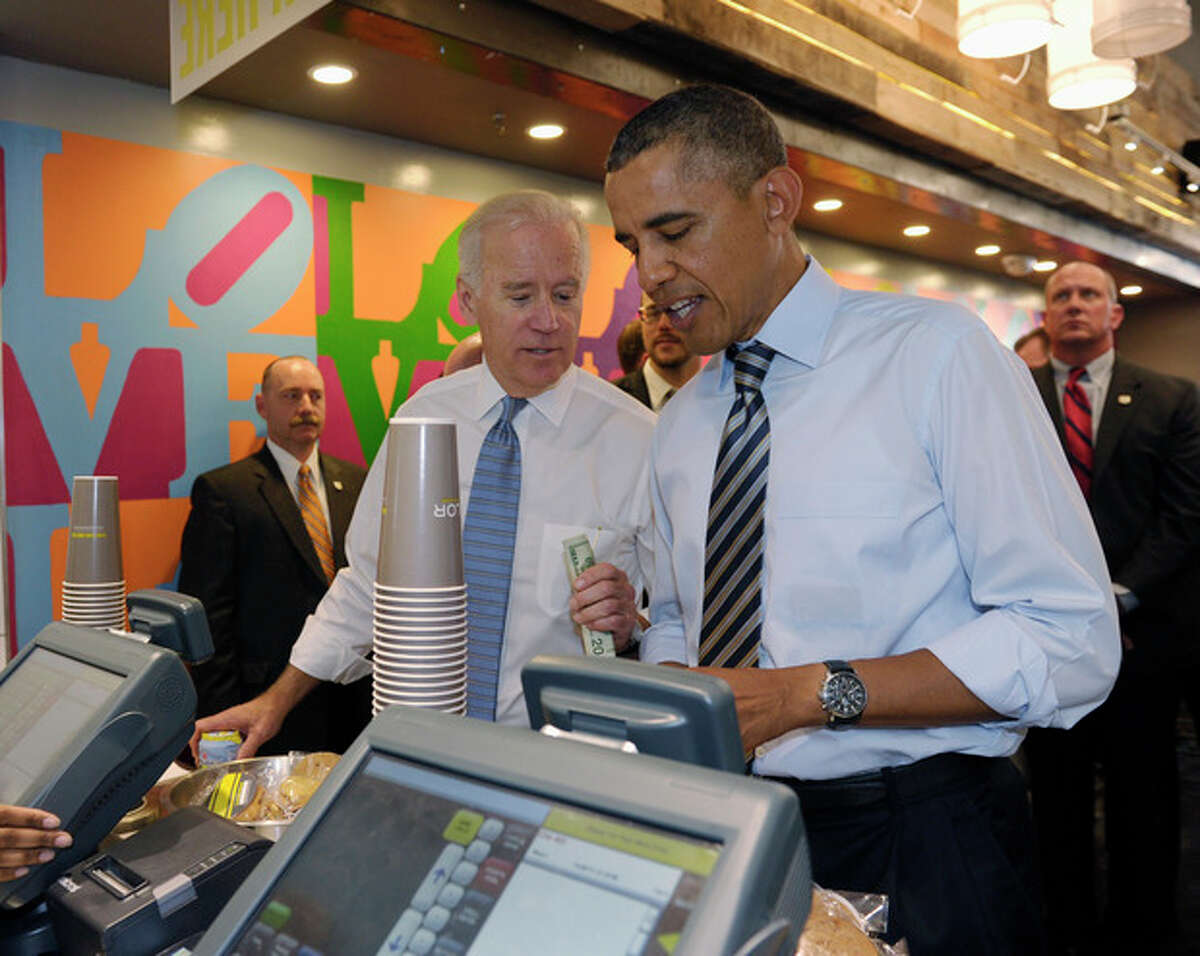 President Barack Obama and Vice President Joe Biden order lunch at Taylor Gourmet sandwich shop near the White House in Washington, Friday, Oct. 4, 2013. The president and vice president stepped out of the White House on a surprise and rare off-campus stroll to grab lunch at a neighborhood eatery. (AP Photo/Susan Walsh)