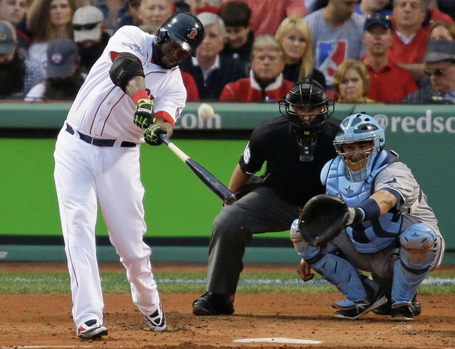 Boston Red Sox's David Ortiz hits a solo home run off Tampa Bay Rays starting pitcher David Price in front of Rays catcher Jose Molina during the first inning in Game 2 of baseball's American League division series, Saturday, Oct. 5, 2013, in Boston. (AP Photo/Stephan Savoia) / AP